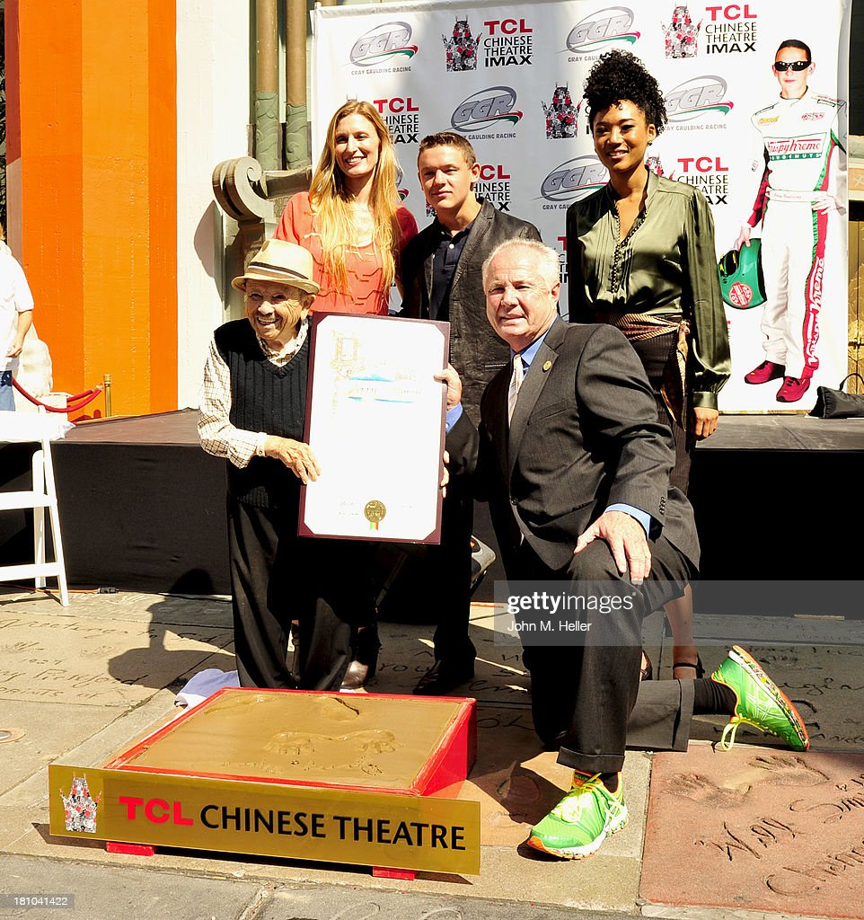 'The Lollipop Kid' actor <a gi-track='captionPersonalityLinkClicked' href=/galleries/search?phrase=Jerry+Maren&family=editorial&specificpeople=3637561 ng-click='$event.stopPropagation()'>Jerry Maren</a>, President of the TCL Chinese Theatre Alwyn Hight Kushner, NASCAR driver/host for the event Gray Gaulding, Los Angeles City Councilman from the 4th District <a gi-track='captionPersonalityLinkClicked' href=/galleries/search?phrase=Tom+LaBonge&family=editorial&specificpeople=220711 ng-click='$event.stopPropagation()'>Tom LaBonge</a> and singer Judith Hill attend the Handprint-Footprint Ceremony for 'The Lollipop Kid' <a gi-track='captionPersonalityLinkClicked' href=/galleries/search?phrase=Jerry+Maren&family=editorial&specificpeople=3637561 ng-click='$event.stopPropagation()'>Jerry Maren</a>, 93, Last Of The Munchkins From 'The Wizard Of Oz' at TCL Chinese Theatre on September 18, 2013 in Hollywood, California.