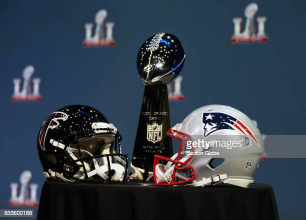 The Lombardi Trophy and the helmets of the two opponents the Atlanta Falcons left and the New England Patriots rest on a table as NFL Commissioner...