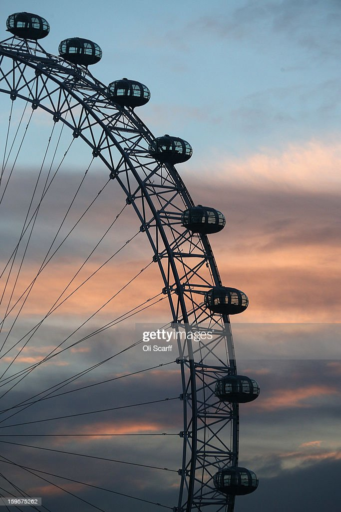 The London Eye Ferris wheel, located on the South bank of the river Thames, rotates at dusk on January 16, 2013 in London, England.