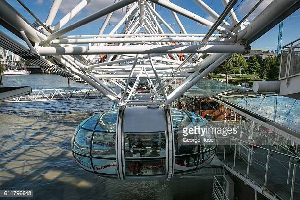 The London Eye is reflected on The Thames River and tour boat docks as viewed on September 11 in London England The collapse of Great Britain appears...