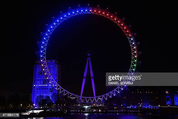 The London Eye overlooking the River Thames is pictured in London on May 1 lit in colours representing the different political parties vying for...