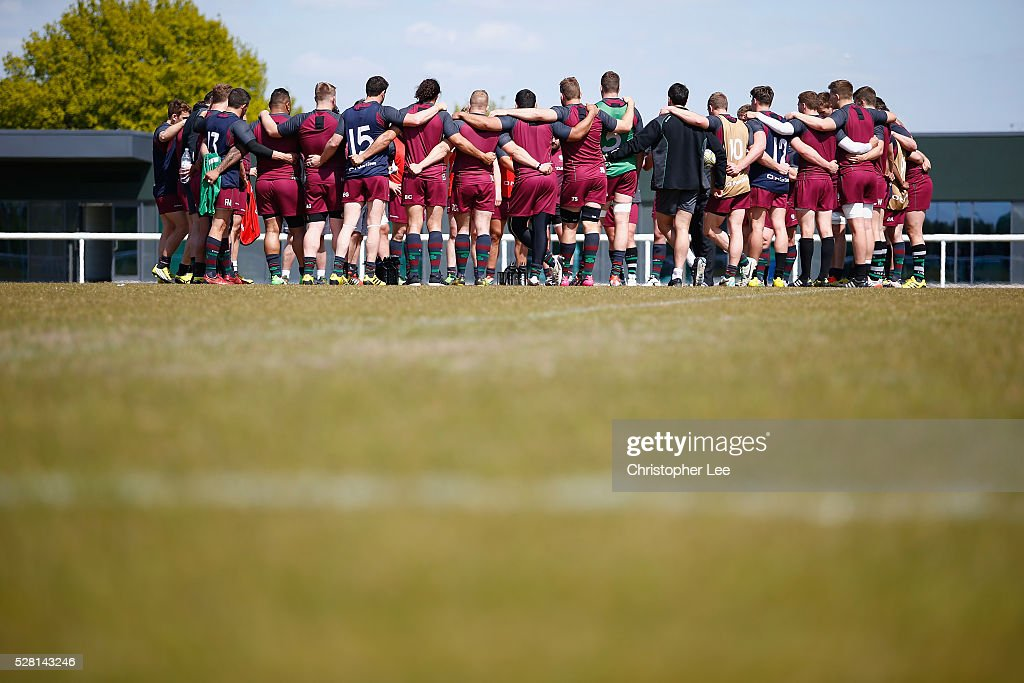 The London Irish team group huddle as they talk tactics in training during the London Irish Media Session at Hazelwood Centre on May 4, 2016 in Sunbury, England.