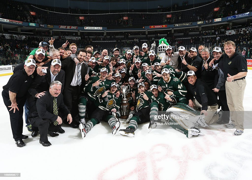 The London Knights pose with the Robertson Cup after defeating the Barrie Colts in Game Seven of the 2013 OHL Championship Final on May 13, 2013 at the Budweiser Gardens in London, Ontario, Canada. The Knights defeated the Colts 3-2 to win the OHL Championship 4-3.