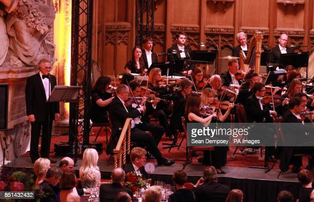 The London Philharmonic Orchestra performing Britten's Young Persons Guide to the Orchestra with John Suchet narrating from the Minstrels Gallery in...