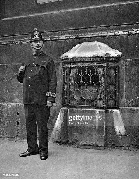The London Stone in the wall of St Swithin's Cannon Street London 19261927 This ancient oolite stone was set into the wall of St Swithin's Church The...