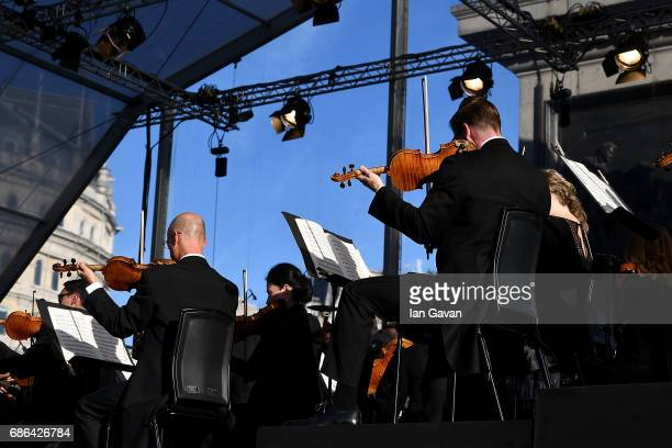 The London Symphony Orchestra gives a free openair concert to a crowd of thousands in London's Trafalgar Square in an annual concert series presented...