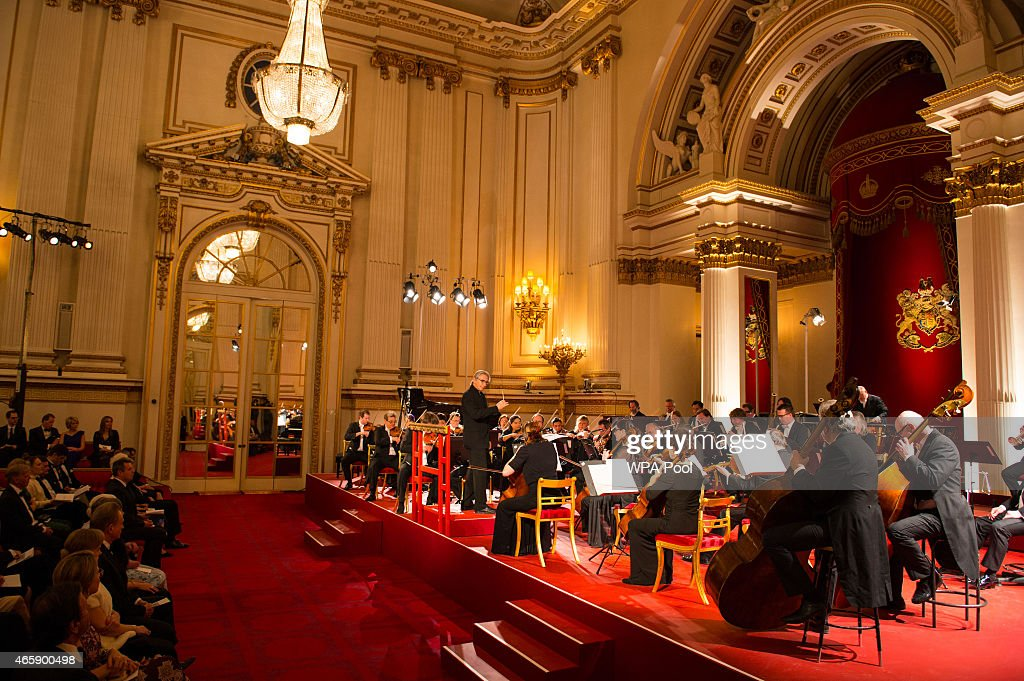 The London Symphony Orchestra (LSO) perform during a reception hosted by Queen Elizabeth II to mark the conclusion of the 'Moving Music' campaign and the long association of conductor Michael Tilson Thomas with the London Symphony Orchestra, at Buckingham Palace on March 11, 2015 in London, United Kingdom.