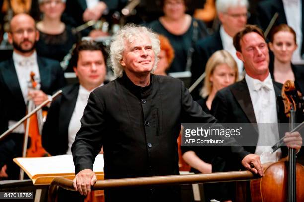 The London Symphony Orchestra's Music Director Simon Rattle arrives to conduct the LSO playing a programme by Helen Grime Thomas Ades Harrison...
