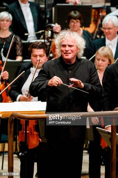 The London Symphony Orchestra's Music Director Simon Rattle pauses between pieces as he conducts the LSO playing a programme by Helen Grime Thomas...