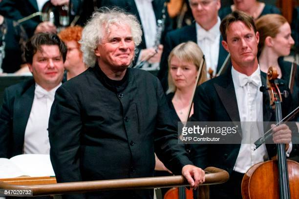 The London Symphony Orchestra's Music Director Simon Rattle smiles as he pauses between pieces as he conducts the LSO playing a programme by Helen...