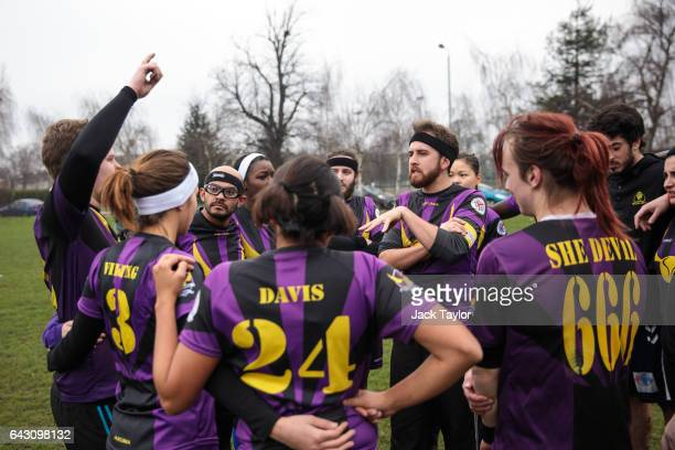 The London Unspeakables quidditch team huddle during the Crumpet Cup quidditch tournament on Clapham Common on February 18 2017 in London England...