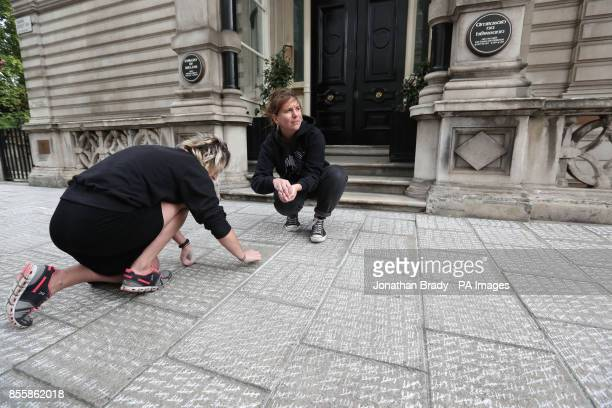 The LondonIrish Abortion Rights campaigners mark over 200000 tally marks in chalk representing the number of Irish women who have travelled to...
