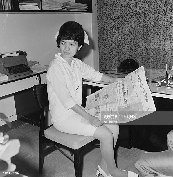 The Lone Survivor Manila Philippines Corazon Amurao lone survivor of the brutal Chicago massacre of eight students nurses last year reads a newspaper...