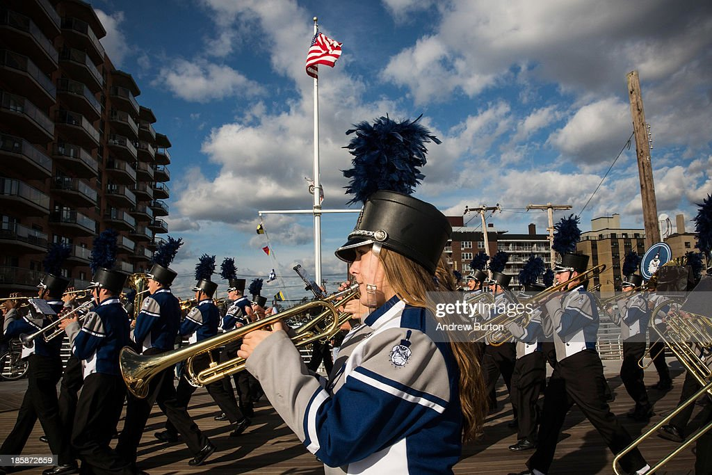 The Long Beach High School marching band plays while marching down the Long Beach boardwalk to officially reopen the boardwalk on October 25, 2013 in Long Beach, New York. The boardwalk was severely damaged by Superstorm Sandy last year, which killed 285 people and caused billions of dollars in damage. Long Beach's new boardwalk is made of Brazilian hardwood and is estimated to have a lifespan of 30-40 year; the previous boardwalk was only scheduled to last three to seven years.