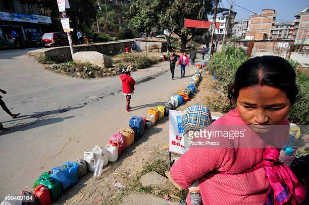 The long empty kerosene containers linedup as people queue for fuel For the past few months neighboring India has blocked the transportation of fuel...