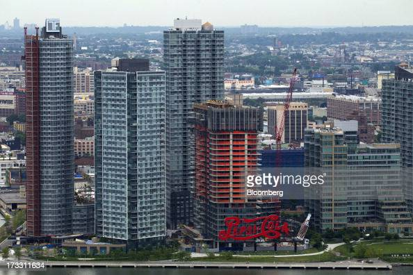 The Long Island City waterfront and the PepsiCola sign are seen from the 34th floor at 50 UN Plaza in New York US on Thursday July 11 2013 Located...