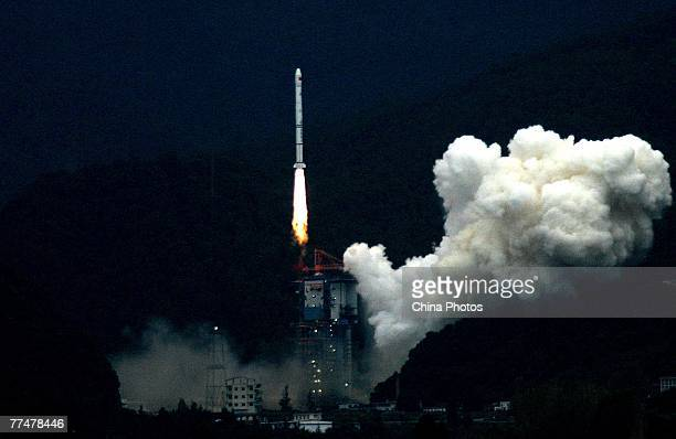 The Long March 3A rocket carrying China's first lunar probe Chang'e I blasts off from its launch pad at the Xichang Satellite Launch Center on...