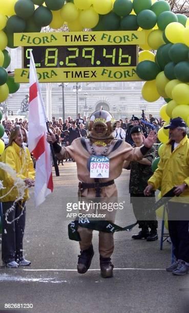The longest ever marathon runner Lloyd Scott crosses the finish line of the 2002 Flora London Marathon on the Mall 19 April 2002 at 1815pm to record...