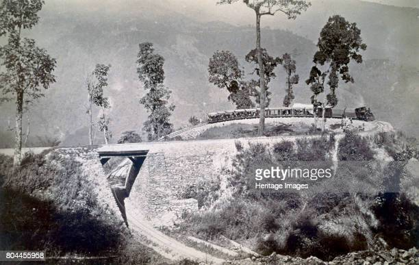 The loop at Agony Point at Tindharia on the Darjeeling Himalayan Railway' 1880s The Darjeeling Himalayan Railway is a narrow gauge line connecting...