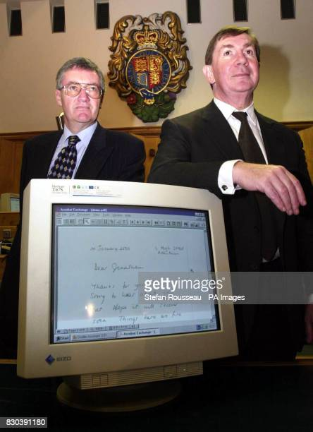 The Lord Chancellor Lord Irvine right and Ian Magee Chief Executive of the Court Service in Court 12 of the Old Bailey London with some of the new...