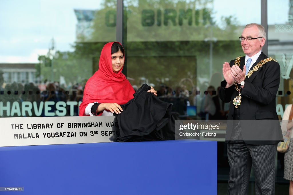 The Lord Mayor of Birmingham Cllr Mike Leddy looks on as <a gi-track='captionPersonalityLinkClicked' href=/galleries/search?phrase=Malala+Yousafzai&family=editorial&specificpeople=5849423 ng-click='$event.stopPropagation()'>Malala Yousafzai</a> opens the new Library of Birmingham at Centenary Square on September 3, 2013 in Birmingham, England. The new futuristic building was officially opened by 16-year-old <a gi-track='captionPersonalityLinkClicked' href=/galleries/search?phrase=Malala+Yousafzai&family=editorial&specificpeople=5849423 ng-click='$event.stopPropagation()'>Malala Yousafzai</a> who was attacked by Taliban gunmen on her school bus near her former home in Pakistan in October 2012. The new building was designed by architect Francine Hoube and has cost 189 million GBP. The modern exterior of interlacing rings reflects the canals and tunnels of Birmingham. The library's ten floors will house the city's internationally significant collections of archives, photography and rare books as well as it's lending library.