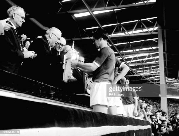The Lord Mayor of London Sir John Perring presents the FA Amateur Cup to Wimbledon captain Roy Law after they beat Sutton United 42 during the final...