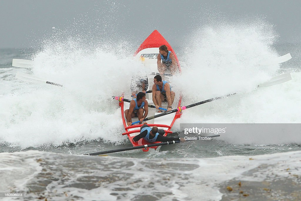 The Lorne surf life saving crew paddle through a wave during the Ocean Thunder Surf Boat Series at Dee Why Beach on February 2, 2013 in Sydney, Australia.