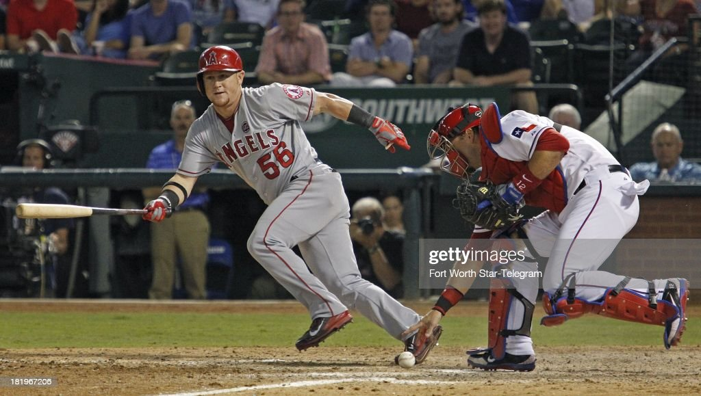 The Los Angeles Angels' Kole Calhoun (56) takes off for first as Texas Rangers catcher A.J. Pierzynski reaches for the dropped third strike to retire Calhoun in the ninth inning at the Rangers Ballpark in Arlington on Thursday, September 26, 2013, in Arlington, Texas. The Rangers won, 6-5.