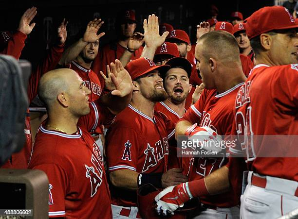 The Los Angeles Angels of Anaheim congratulate Mike Trout on a grand slam home run against the Minnesota Twins during the second inning of the game...