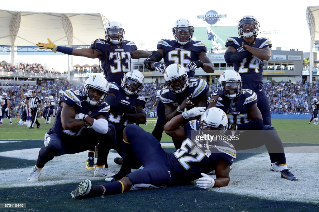 The Los Angeles Chargers defense celebrate after an interception during the NFL game against the Buffalo Bills at the StubHub Center on November 19, 2017 in Carson, California.
