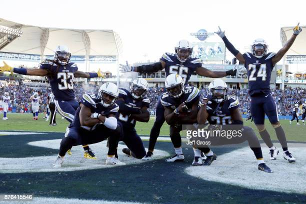 The Los Angeles Chargers defense celebrate after an interception during the NFL game against the Buffalo Bills at the StubHub Center on November 19...