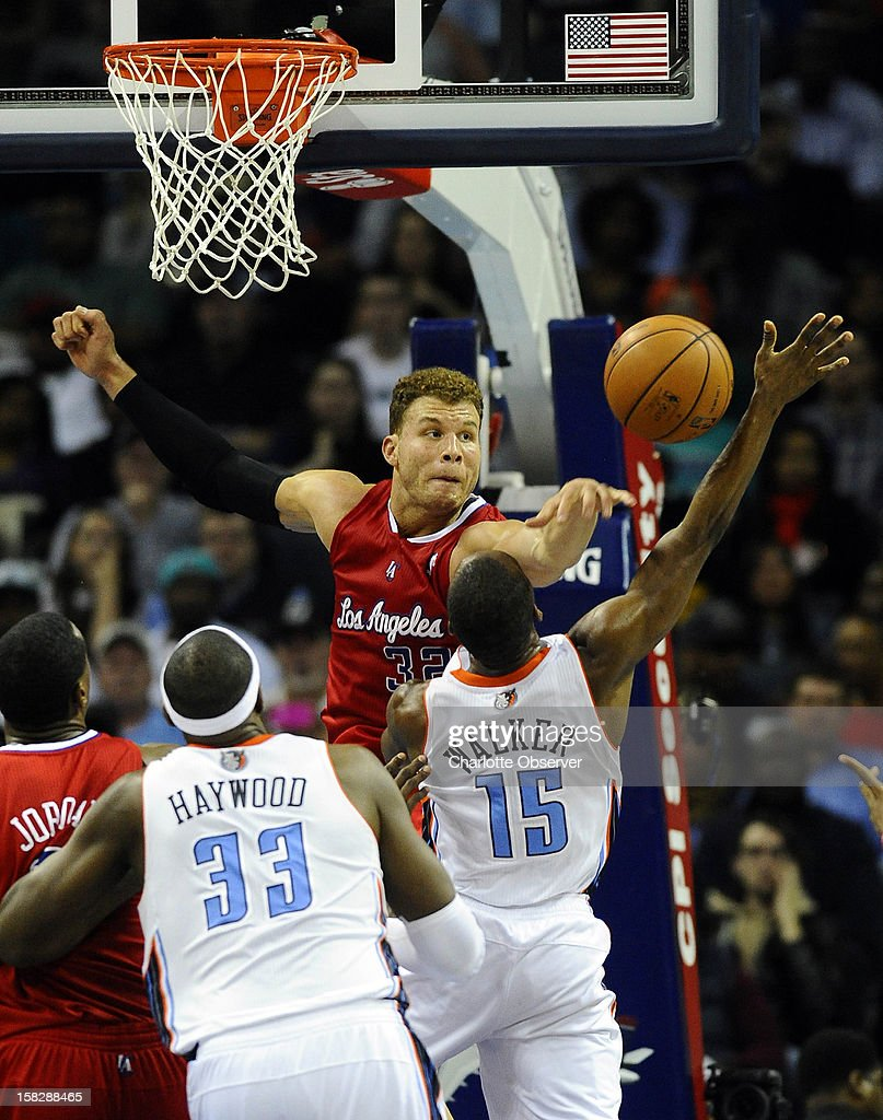 The Los Angeles Clippers' Blake Griffin, top, blocks the shot of the Charlotte Bobcats' Kemba Walker (15) in the second half at Time Warner Cable Arena in Charlotte, North Carolina, on Wednesday, December 12, 2012. The Clippers won, 100-94.