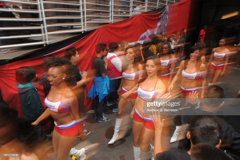 The Los Angeles Clippers dace team runs out before the game against the Memphis Grizzlies at Staples Center on March 13, 2013 in Los Angeles, California.