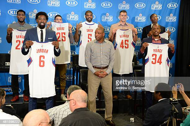 The Los Angeles Clippers hold up their jerseys at a press conference at STAPLES Center on July 21 2015 in Los Angeles California NOTE TO USER User...