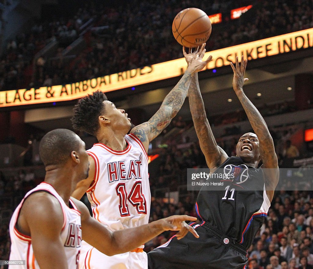 The Los Angeles Clippers' Jamal Crawford, right, shoots over the Miami Heat's Gerald Green (14) in the fourth quarter at the AmericanAirlines Arena in Miami on Sunday, Feb. 7, 2016. The Clippers won, 100-93.