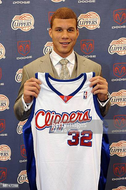 The Los Angeles Clippers number one draft pick Blake Griffin from the University of Oklahoma poses with his Clippers jersey during a press conference...