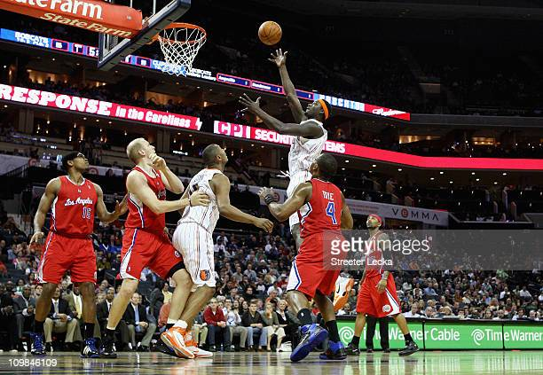 The Los Angeles Clippers watch as Kwame Brown of the Charlotte Bobcats takes a shot during their game at Time Warner Cable Arena on March 7 2011 in...