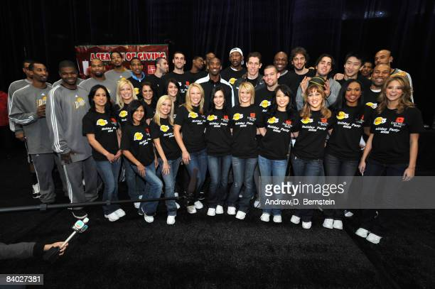 The Los Angeles DFenders Los Angeles Lakers and the Laker Girls pose for a photograph at the 2008 Los Angeles Lakers holiday party at Toyota Sports...