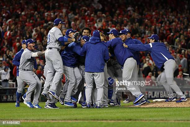 The Los Angeles Dodgers celebrate after winning game five of the National League Division Series over the Washington Nationals 43 at Nationals Park...