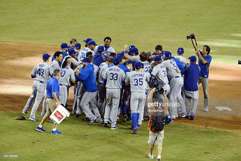 The Los Angeles Dodgers celebrate clinching the National League West Title against the Arizona Diamondbacks after a 7-6 win at Chase Field on September 19, 2013 in Phoenix, Arizona.