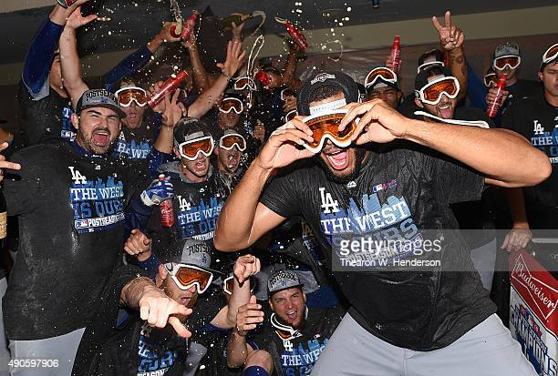 The Los Angeles Dodgers celebrates in the locker room with champagne and beer after they defeated the San Francisco Giants 80 to clinch the National...