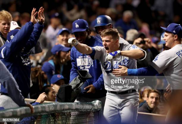 The Los Angeles Dodgers' Enrique Hernandez celebrates his grand slam in the third inning against the Chicago Cubs in Game 5 of the National League...
