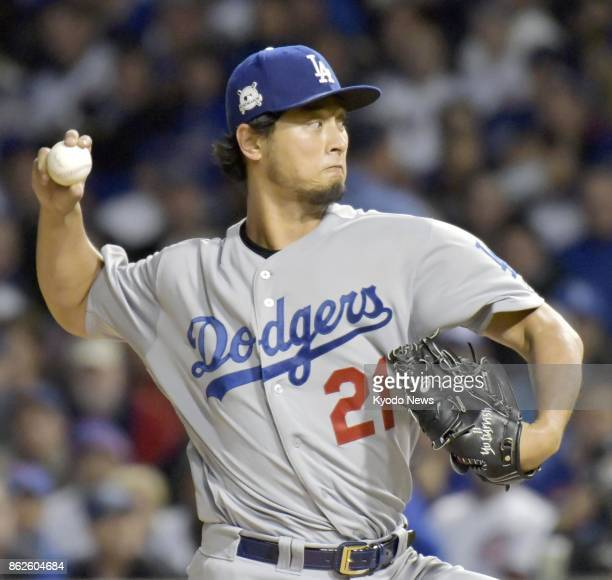 The Los Angeles Dodgers' Yu Darvish pitches against the Chicago Cubs in Game 3 of the National League Championship Series at Wrigley Field in Chicago...
