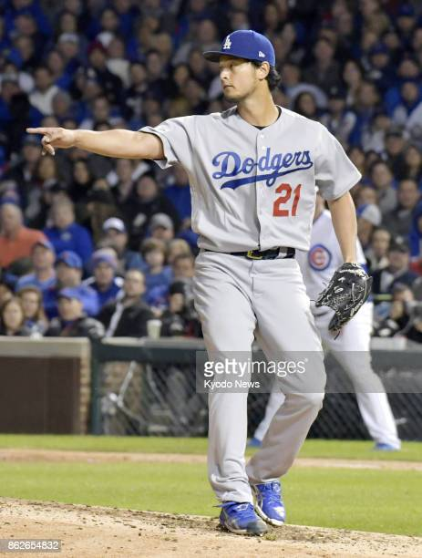 The Los Angeles Dodgers' Yu Darvish points to his teammates in Game 4 of the National League Championship Series against the Chicago Cubs on Oct 17...