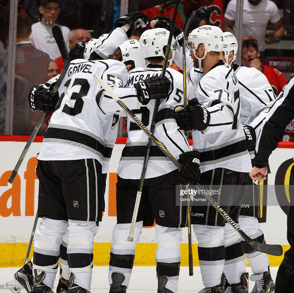 The Los Angeles King celebrate after a goal against the Calgary Flames at Scotiabank Saddledome on April 5, 2016 in Calgary, Alberta, Canada.