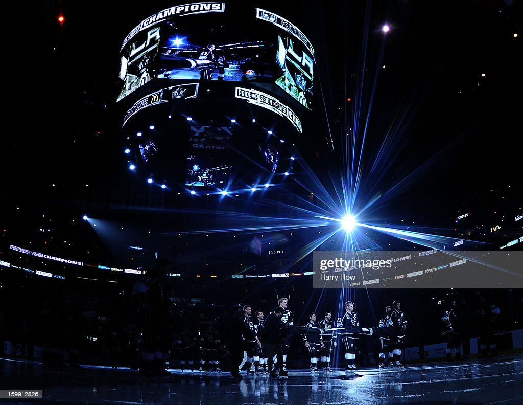 The Los Angeles Kings carry the 2011-12 Stanley Cup banner during a banner raising ceremony before the NHL season opening game against the Chicago Blackhawks at Staples Center on January 19, 2013 in Los Angeles, California.