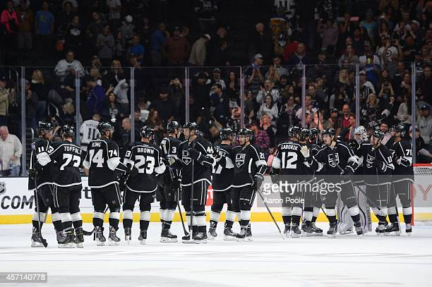 The Los Angeles Kings celebrate a win after a game against the Winnipeg Jets at STAPLES Center on September 12 2014 in Los Angeles California