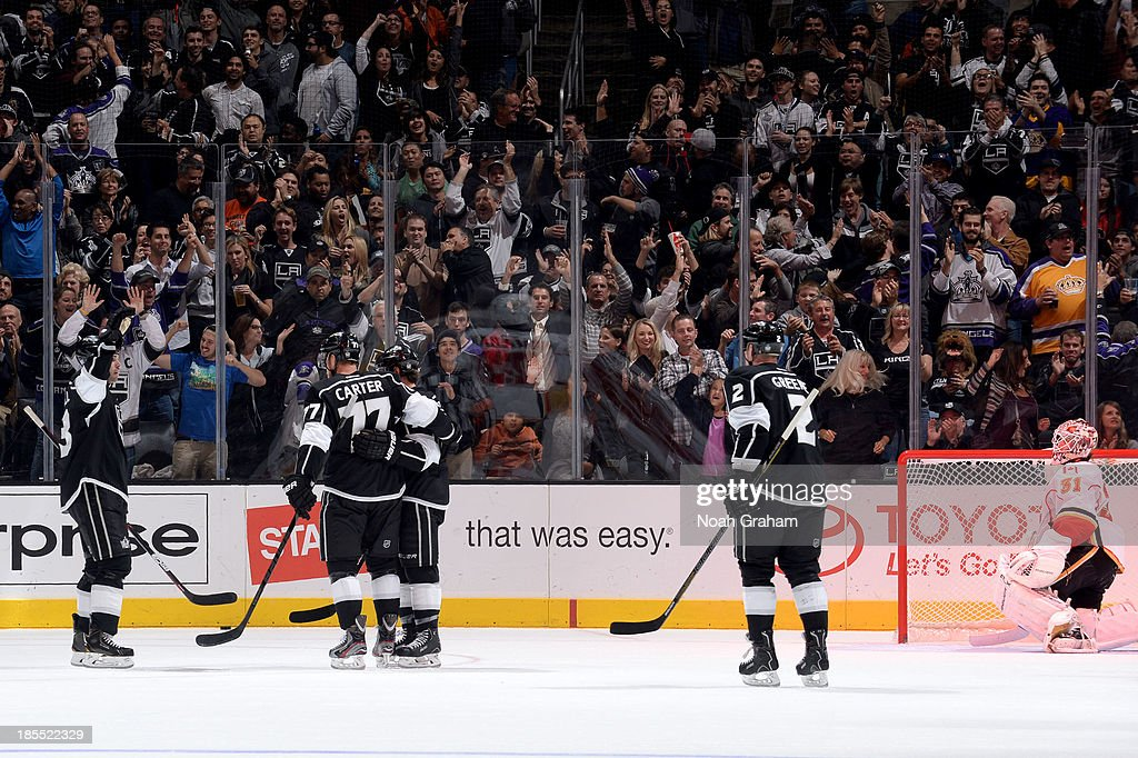 The Los Angeles Kings celebrate after a goal against the Calgary Flames at Staples Center on October 21, 2013 in Los Angeles, California.