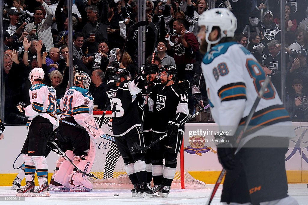 The Los Angeles Kings celebrate after a goal against the San Jose Sharks in Game Seven of the Western Conference Semifinals during the 2013 NHL Stanley Cup Playoffs at Staples Center on May 28, 2013 in Los Angeles, California.