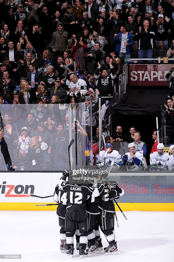 The Los Angeles Kings celebrate after a goal against the Vancouver Canucks at Staples Center on January 28, 2013 in Los Angeles, California.